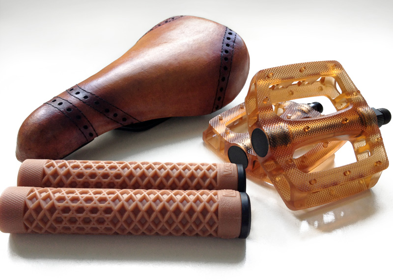 Brown BMX parts in leather, rubber and polycarbonate
